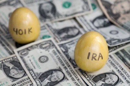 Retirement golden eggs on dollars, IRA in focus, 401k blurry